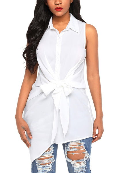 Front view of  model wearing white tie-front buttons asymmetrical sleeveless top