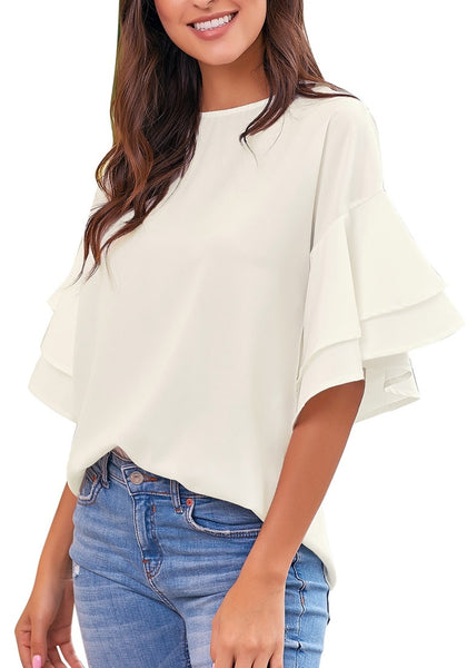 Front view of model wearing white trumpet sleeves keyhole-back blouse
