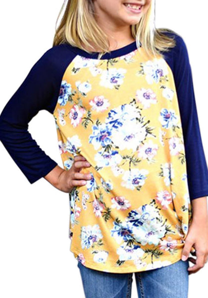 Front view of model wearing yellow floral print raglan sleeves girl tunic for her
