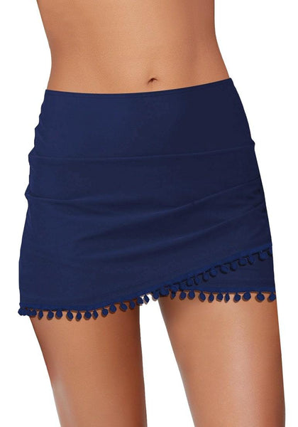Front view of navy tulip hem tassels mid-waist ruched swim skirt