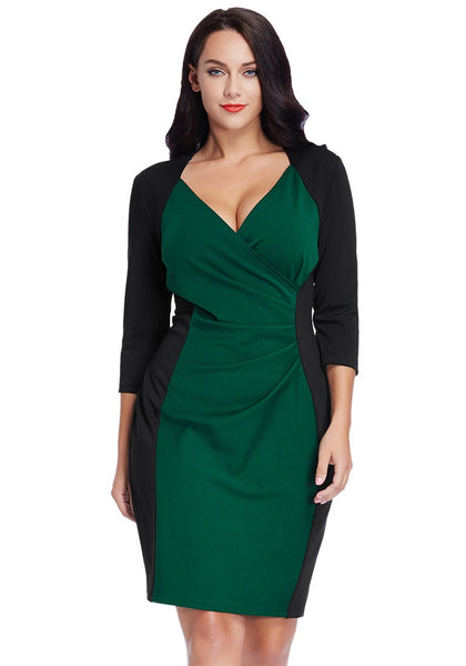 Front view of pretty model in plus size green raglan sleeve dress