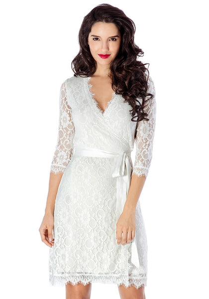 Front view of pretty model in white lace overlay plunge wrap-style dress