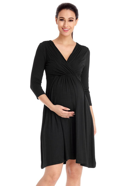 Front view of pretty model wearing black V neckline ruched surplice maternity dress