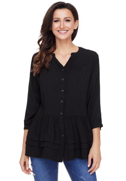 Front view of pretty model wearing black button-front puffed sleeves tunic
