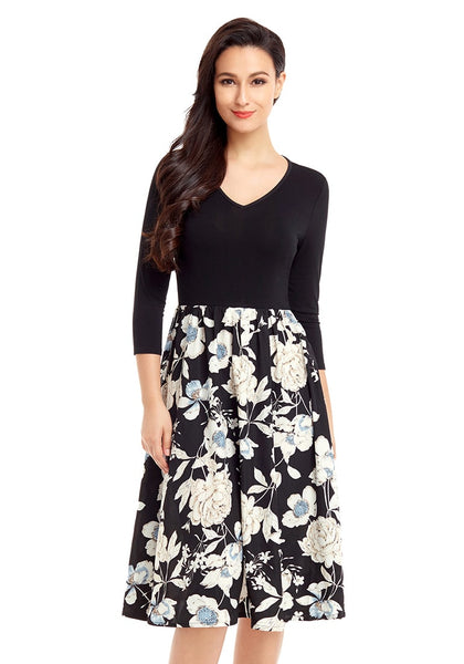 Front view of pretty model wearing black floral-bottom V neckline crop sleeves skater dress