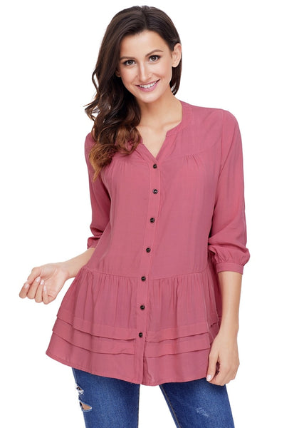 Front view of pretty model wearing deep blush button-front puffed sleeves tunic