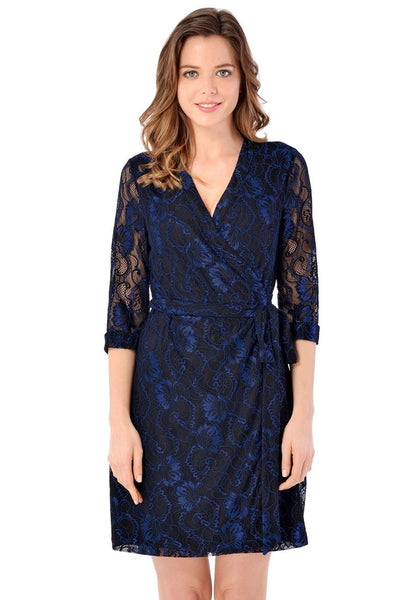 Front view of pretty model wearing navy floral lace V neckline true wrap dress