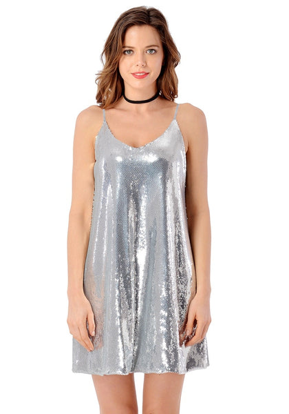 Front view of pretty model wearing silver sequins slip dress
