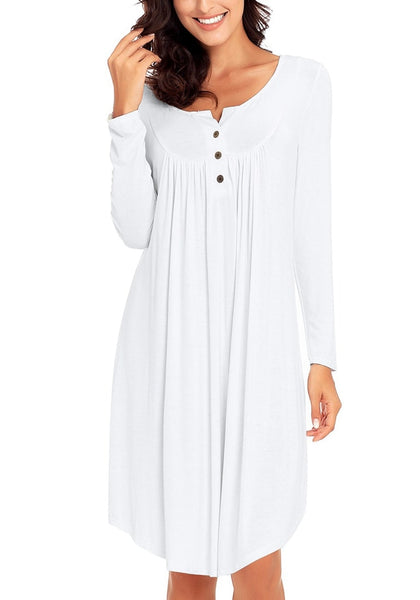 Front view of pretty model wearing white long sleeves curved hem henley dress