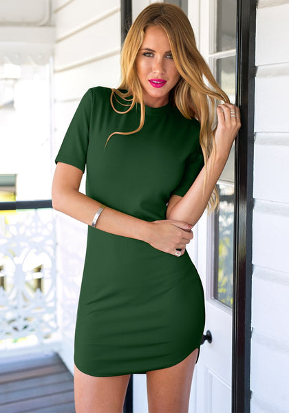 Front view of  sexy model in dark green curved hem bodycon dress