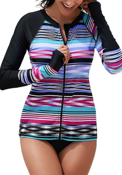 Front view of sexy model wearing black striped zip-front long sleeves rash guard