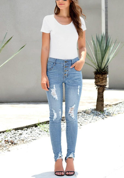 Front view of sexy model wearing light blue high-rise ripped denim buttoned denim jeans