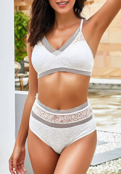 Front view of sexy model wearing white fishnet-trim high waist lace bikini set