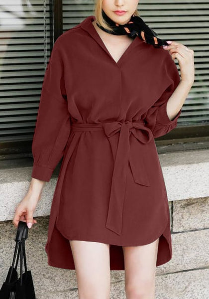 Front view of woman in burgundy tie belt shirt dress