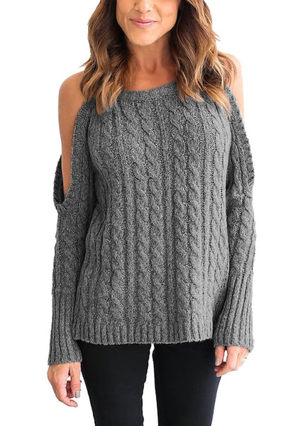 Front view of woman in grey cold-shoulder cable knit sweater