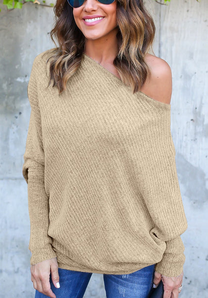 Front view of woman in khaki off-shoulder bat sleeves sweater