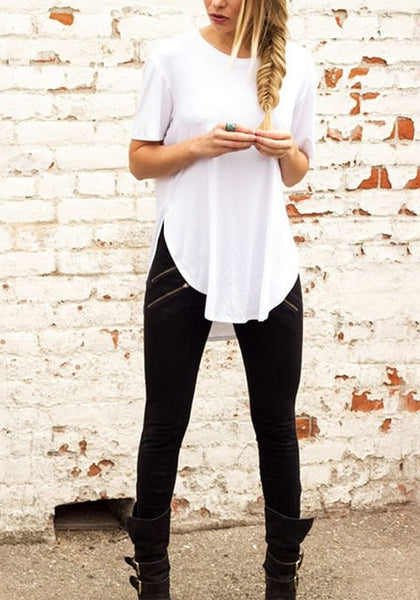 Front view of woman in white curved hem classic tee and black jeans
