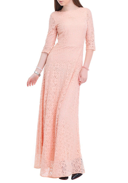 Front view of woman posing in a pink maxi lace dress