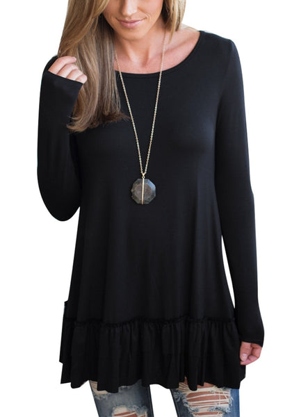 Front view of woman wearing black layered ruffle-hem long sleeves tunic