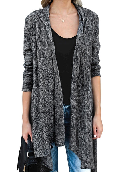 Front view of woman wearing black long sleeves knitted open front tassel cardigan