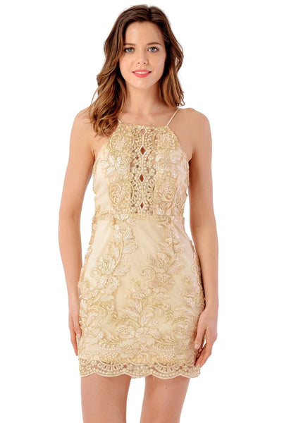 Front view of woman wearing champagne floral embroidered scallop slip dress