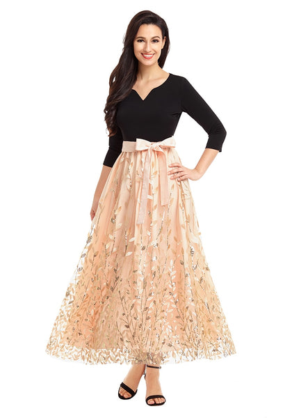 Front view of woman wearing champagne leaf pattern sequins bowknot maxi dress