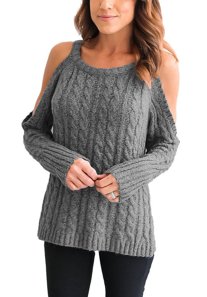 Front view of woman wearing grey cold-shoulder cable knit sweater