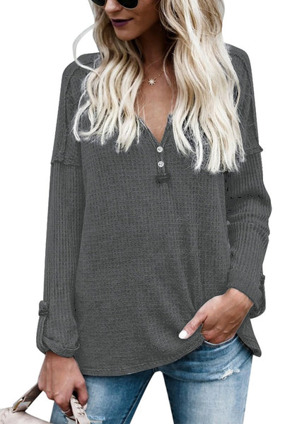 Front view of woman wearing grey front buttons roll-up sleeves textured top
