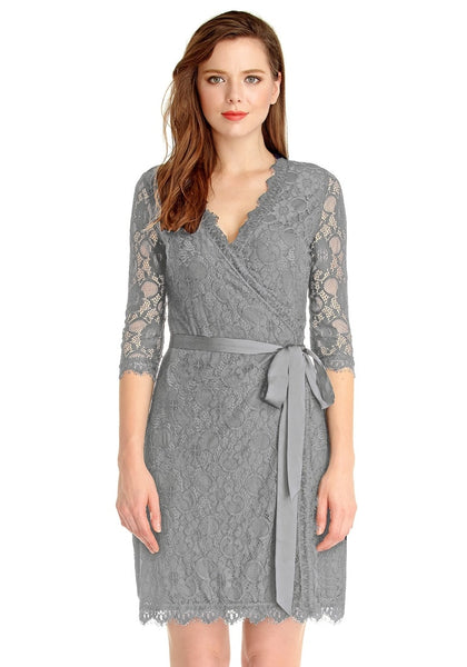 Front view of woman wearing grey lace overlay plunge wrap-style dress