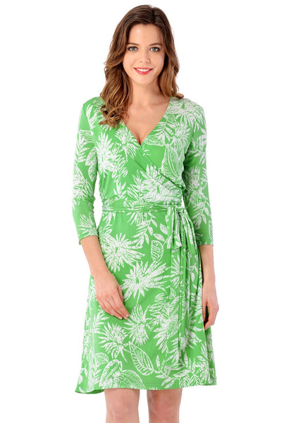 Front view of woman wearing light green plant-print crop sleeves faux wrap dress