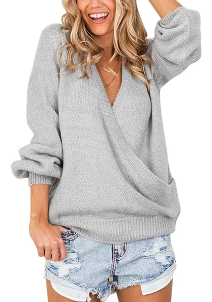 Front view of woman wearing light grey lantern sleeves surplice sweater