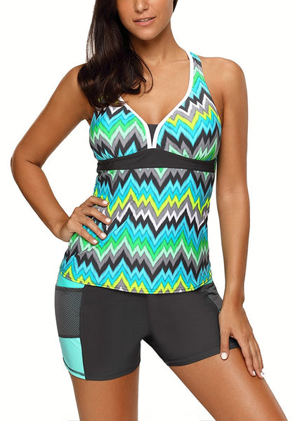 Front view of woman wearing mint chevron print tankini set