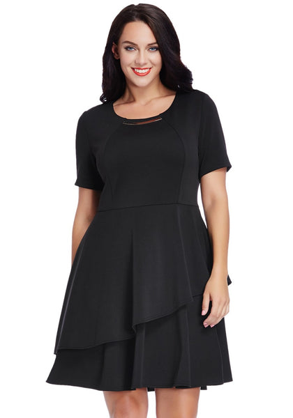 Front view of woman wearing plus size black asymmetric layered skater dress