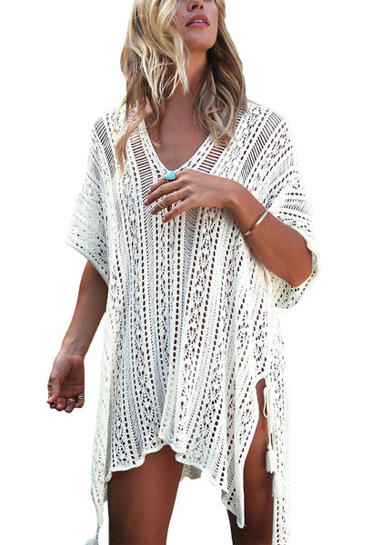 Front view of woman wearing pretty white crochet lace-up side beach cover-up