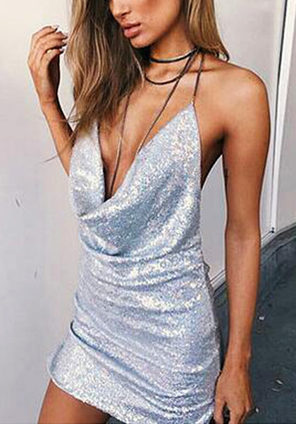 Front view of woman wearing silver cowl-neck open-back sequin dress