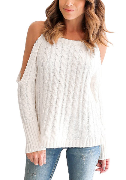 Front view of woman wearing white cold-shoulder cable knit sweater