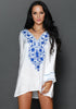 Front view of women wearing white floral embroidered v neck beach cover-up