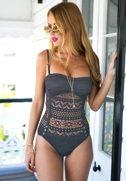 Front view shot of model wearing a grey lace halter swimsuit
