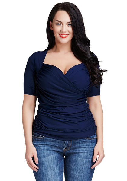 Frontal shot of a black-haired girl in a navy blue ruched surplice top
