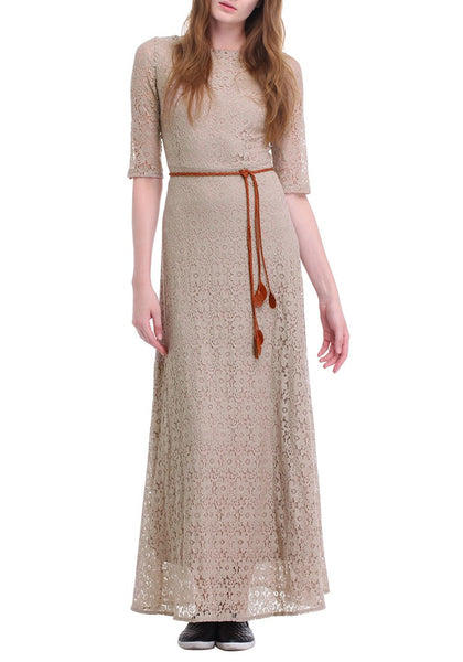 Frontal shot of woman in a khaki maxi lace dress
