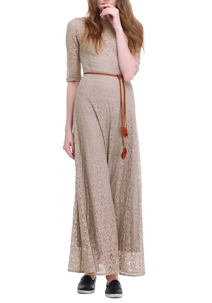 Frontal view of woman posing in a khaki maxi lace dress