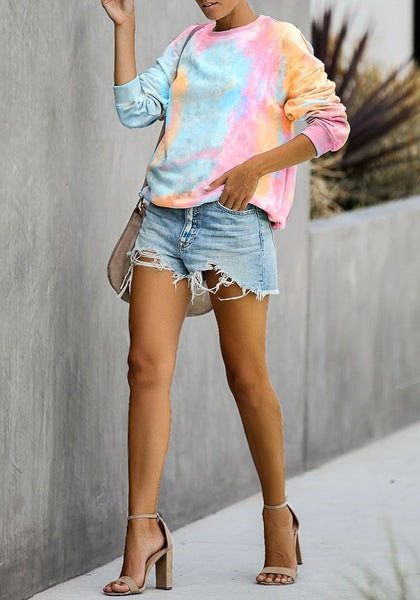 Front full body of model wearing pink and yellow tie-dye drop shoulder pullover sweater