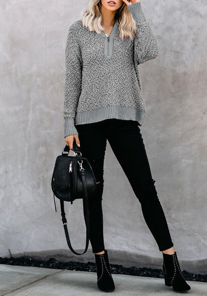 Front full body shot of model wearing grey half-zip turtleneck popcorn fuzzy fleece sweater