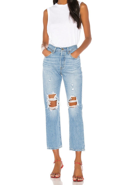 Front full body shot of model wearing light blue high-waist ripped denim cropped jeans