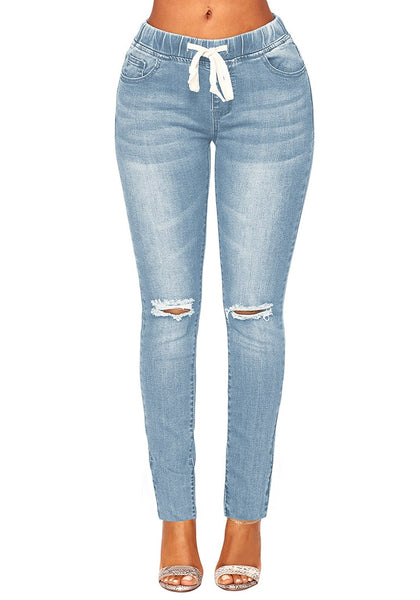 Front view of light blue drawstring-waist washout ripped skinny jeans