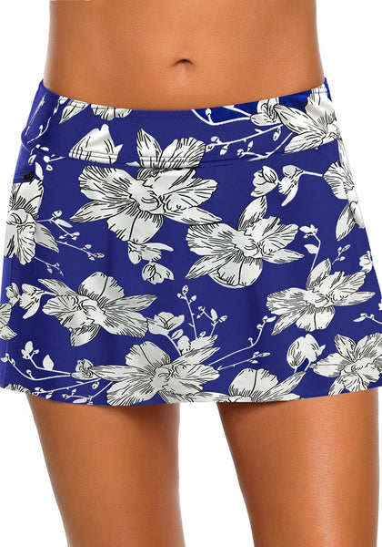 Front view of model in royal blue zipper-pocket waistband floral-print skirted bikini bottom