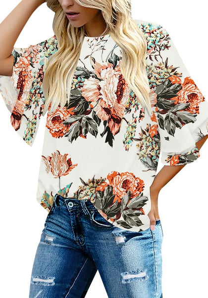 Front view of model wearing apricot trumpet sleeves keyhole-back printed blouse