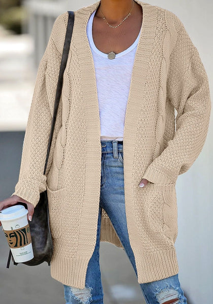 Front view of model wearing beige open-front oversized cable knit cardigan