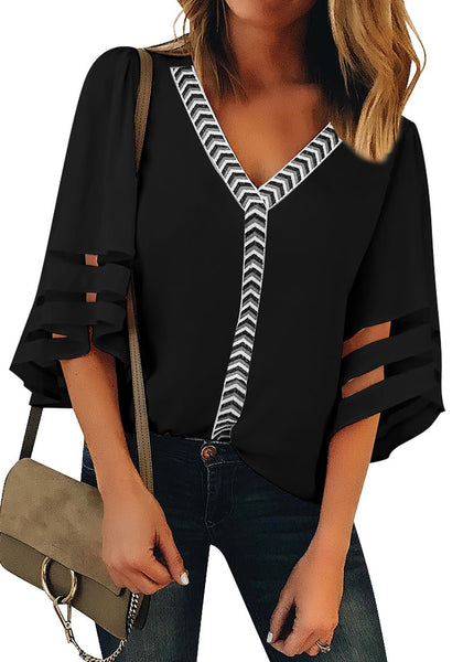 Front view of model wearing black 34 bell mesh panel sleeves V-neckline embroidered top