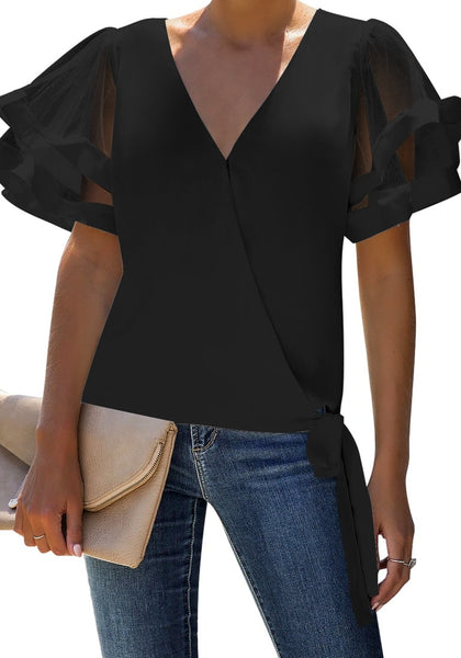 Front view of model wearing black V-back mesh butterfly sleeves side-tie wrap top